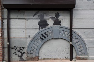 Our Recent Local Banksy Piece Gets the Plexiglass and Gate Treatment