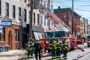 Fire on Wyckoff Avenue Spread Across Three Rooftops Tuesday Afternoon