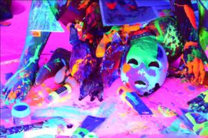 Watch a Bushwick Born Artist As He Covers People in Glow-in-the-Dark Paint